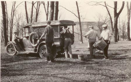 Leaves being loaded into the college's Dodge truck on Arbor Day, early 1930s.